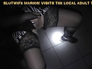 Naughty wife gangbanged at the local Adult Theater